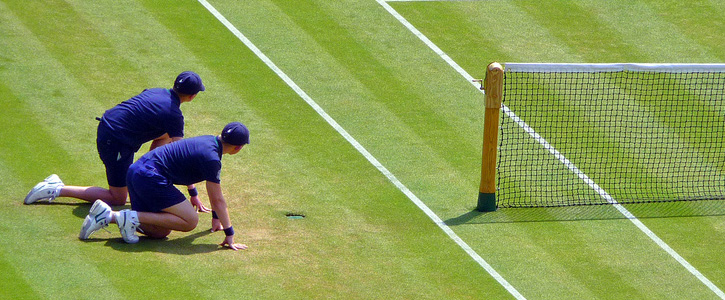 Two Ball Boys On A Grass Court