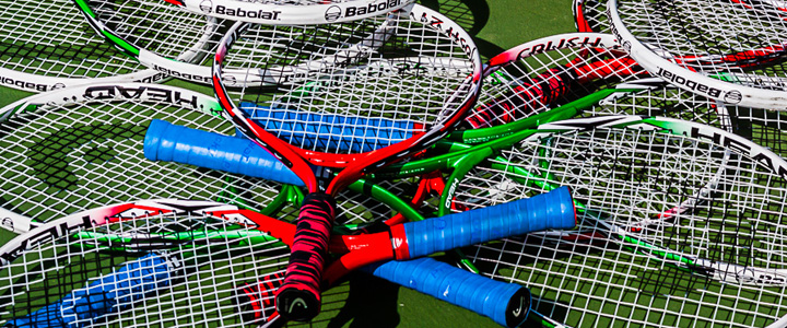 A Pile of Kids Tennis Racquets