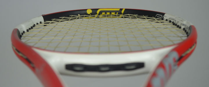 A photograph of a tennis racquet strung with Tecnifibre X-One Biphase looking down the front of the racquet.