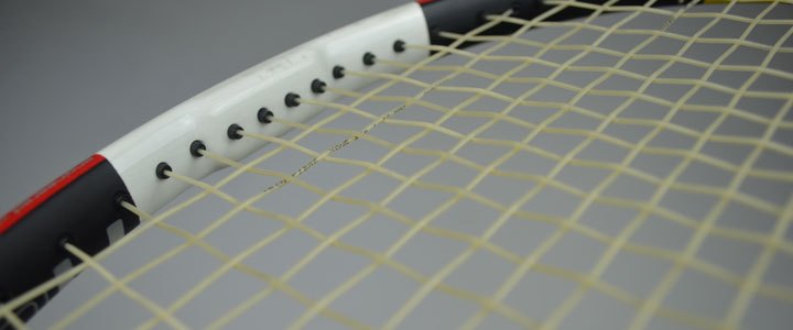 An up-close photograph of the writing on the string of Tecnifibre X-One Biphase strung on a racquet.